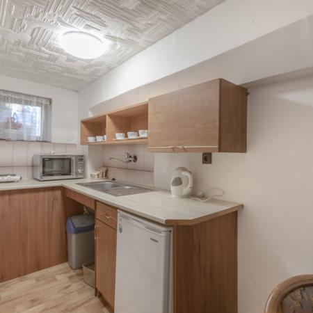 čtyřlůžkový pokoj, čtyři lůžka, osmilůžák, kuchyňský kout,